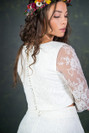 A classic and traditional styled bridal top with sheer, illusion lace sleeves. This ¾ sleeve length bridal top has a flattering boat neckline and pretty covered buttons running down the back. The Le Fay top features here with the Le Fay skirt.