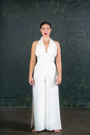 Made from 100% silk with a flattering halter-neck and removable swathe of fabric to mark the transition from 'bride to boogie'. The boned corset cinches in the waist at the perfect point creating a beautiful silhouette.