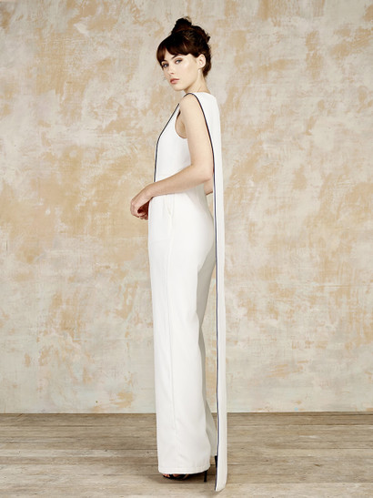 Made from luxurious Italian crepe and with black piping handmade in London. The Bouilly from House of Ollichon is made in England. Be a Super Bride!