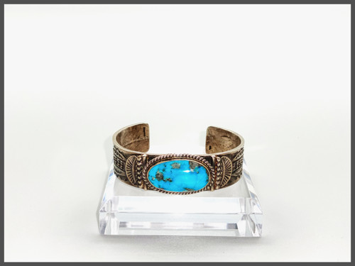Large oval Royston turquoise stone with sterling silver cuff with hand chasing. A piece created by Oscar Alevius.