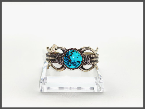 Round oval Royston turquoise center stone, sterling silver cuff. This piece was created by W. Begay.