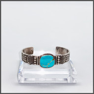 Royston turquoise with sterling silver chased cuff. Created by Oscar Alevius.