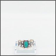 Oval Royston turquoise stone on sterling silver cast cuff.