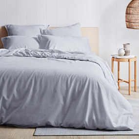 Mist Blue Quilt Cover Set on wooden bed frame, next to wooden side table and light shade