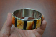 Orange Lion Paw Shell Stainless Steel Bangle Bracelet 1""