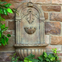 Sunnydaze Florence Solar with Battery Backup Outdoor Wall Mounted Water Fountain - Outdoor Water Feature with Rechargeable Solar Battery - Florentine Stone - 27-Inch