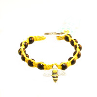 HOTI Hemp Handmade Yellow Bee Peruvian Ceramic Bead Yellow Hemp Black Wood Beads Ladies Womens Bracelet Hand Crafted Made in Toronto Made in Ontario Made in Canada Boho Tattoo Rocker Beaded Crow Beads 420 Alligator Clip Roach Clip Clip It Clip Toronto Ontario Canada