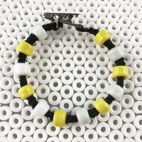 HOTI Hemp Handmade Black Hemp Hockey Puck Drop Yellow White Glass Crow Beads Mens Bracelet Hand Crafted Made in Toronto Made in Ontario Made in Canada Beaded Crow Beads Glass Beads 420 Alligator Clip Roach Clip Clip It Clip Canadian Toronto Ontario Canda