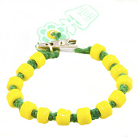 HOTI Hemp Handmade Green Hemp Hockey Puck Drop Yellow Glass Crow Beads Mens Bracelet Hand Crafted Made in Toronto Made in Ontario Made in Canada Beaded Crow Beads Opaque Glass Beads 420 Alligator Clip Roach Clip Clip It Clip Toronto Ontario Canada Canadian