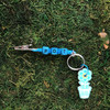 HOTI Hemp Handmade Pot Turquoise Blue Hemp Keychain Key Chain Wood Cube Square Alphabet Beads Word Up Roach Clip Made in Canada Hand Crafted Made in Toronto Made in Ontario Beaded Weed Pot Accessory Cannabis Marijuana Accessories Stoner Gift Mary Jane 420 Clip-It Alligator Clip Canadian Toronto Ontario Canada