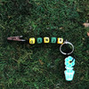 HOTI Hemp Handmade Ganja Black Hemp Keychain Key Chain Wood Cube Square Alphabet Beads Multi Colour Yellow Green Word Up Roach Clip Made in Canada Hand Crafted Made in Toronto Made in Ontario Beaded Men's Ladies Woman Women's Unisex 420 Dope Stoner Gift Cannabis Accessory Marijuana Mary Jane Pot Weed Accessories Clip-It Alligator Clip Canadian Clip Toronto Ontario Canada