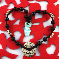 HOTI Hemp Handmade Dalmatian Jasper Spotted Donut of Healing Black Wood Bead Cream White Spots Natural Buri Nuts Beads Black Hemp Crystal Dalmatian Stone Semiprecious Dalmatine Mineral Ladies Women's DOH! Collection Knotted Necklace Hand Crafted Made in Toronto Made in Ontario Made in Canada Boho Chic Beaded Toronto Ontario Canada Canadian Made