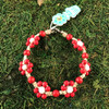 HOTI Hemp Handmade Beige Natural Hemp Daisy Chain Signature Flower Power Anklet Red White Round Beads Beaded Flowers Floral Ladies Women's Jewellery Woman Girls Ankle Bracelet Hand Crafted Made in Canada Made in Toronto Made in Ontario Boho Chic Clasp-It Lobster Claw Clasp Toronto Ontario Canada Canadian Jewelry