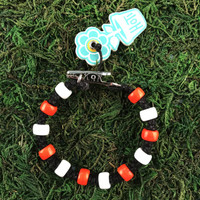 HOTI Hemp Handmade Black Hemp Hockey Puck Drop Orange White Glass Crow Beads Mens Man Roach Clip Bracelet Hand Crafted Jewellery Made in Toronto Made in Ontario Made in Canada Beaded Crow Beads Glass Beads 420 Cannabis Marijuana Accessory Weed Pot Stoner Accessories Clip It Alligator Clip Clasp Toronto Ontario Canada Canadian NHL Inspired Men's Jewelry