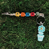 HOTI Hemp Handmade Blunt Natural Hemp Keychain Key Chain Wood Cube Square Alphabet Beads Multi Colour Red Turquoise Blue Yellow Green Orange Word Up Roach Clip Made in Canada Hand Crafted Made in Toronto Made in Ontario Beaded Cannabis Accessory Weed Pot Marijuana Accessories 420 Stoner Gift Clip-It Alligator Clip Canadian Clip Toronto Ontario Canada
