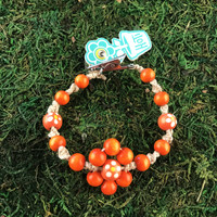 HOTI Hemp Handmade Flower Power Beige Natural Hemp Orange Floral Imperfectly Painted Wood Round Beads Women's Ladies Woman Beaded Jewellery Roach Clip Bracelet Hand Crafted Original Signature Spiral Twisted Knots Knotted Made in Toronto Made in Ontario Made in Canada Wood Beads Round Beads 420 Cannabis Accessory Marijuana Mary Jane Weed Accessories Dope Stoner Gift Pot Mini Metal Alligator Clip Clip It Clip Toronto Ontario Canada Canadian Jewelry