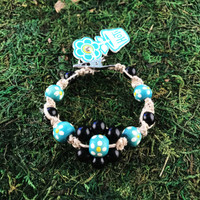 HOTI Hemp Handmade Flower Power Beige Natural Hemp Turquoise Blue Black Floral Imperfectly Painted Wood Round Beads Women's Ladies Woman Beaded Jewellery Roach Clip Bracelet Hand Crafted Original Signature Spiral Twisted Knots Knotted Made in Toronto Made in Ontario Made in Canada Wood Beads Round Beads 420 Cannabis Accessory Marijuana Mary Jane Weed Accessories Dope Stoner Gift Pot Mini Metal Alligator Clip Clip It Clip Toronto Ontario Canada Canadian Jewelry