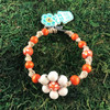 HOTI Hemp Handmade Flower Power Beige Natural Hemp Orange White Floral Imperfectly Painted Wood Round Beads Women's Ladies Woman Beaded Jewellery Roach Clip Bracelet Hand Crafted Original Signature Spiral Twisted Knots Knotted Made in Toronto Made in Ontario Made in Canada Wood Beads Round Beads 420 Cannabis Accessory Marijuana Mary Jane Weed Accessories Dope Stoner Gift Pot Mini Metal Alligator Clip Clip It Clip Toronto Ontario Canada Canadian Jewelry