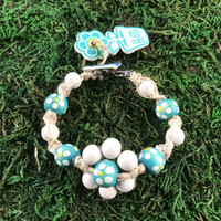 HOTI Hemp Handmade Flower Power Beige Natural Hemp Turquoise Blue White Floral Imperfectly Painted Wood Round Beads Women's Ladies Woman Beaded Jewellery Roach Clip Bracelet Hand Crafted Original Signature Spiral Twisted Knots Knotted Made in Toronto Made in Ontario Made in Canada Wood Beads Round Beads 420 Cannabis Accessory Marijuana Mary Jane Weed Accessories Dope Stoner Gift Pot Mini Metal Alligator Clip Clip It Clip Toronto Ontario Canada Canadian Jewelry