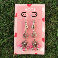 HOTI Hemp Handmade Floral Bells of Joy Antique Silver Pink Metallic Women's Ladies Woman Her Flower Power Roach Clip Earrings Dangling Metal Hollow Petal Charm Hand Crafted Made in Toronto Made in Ontario Made in Canada Flowers Mini Steel Bell Signature Sterling Silver Ear Wires Paper Earring Card 420 Alligator Clips Marijuana Mary Jane Cannabis Clip It Roach Clips Dope Stoner Gift Toronto Ontario Canada Canadian Valentine's Day