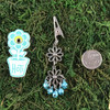 HOTI Hemp Handmade Floral Bells of Joy Antique Silver Pale Light Blue Metallic Women's Ladies Woman Her Flower Power Roach Clip Dangling Metal Hollow Petal Charm Hand Crafted Made in Toronto Made in Ontario Made in Canada Flowers Mini Steel Bell Signature 420 Alligator Clips Marijuana Mary Jane Cannabis Clip It Weed Pot Roach Clips Dope Stoner Gift Toronto Ontario Canada Canadian