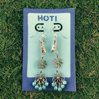 HOTI Hemp Handmade Floral Bells of Joy Antique Silver Pale Light Blue Metallic Women's Ladies Woman Her Flower Power Roach Clip Earrings Dangling Metal Hollow Petal Charm Hand Crafted Made in Toronto Made in Ontario Made in Canada Flowers Mini Steel Bell Signature Sterling Silver Ear Wires Paper Earring Card 420 Alligator Clips Marijuana Mary Jane Cannabis Clip It Weed Pot Roach Clips Dope Stoner Gift Toronto Ontario Canada Canadian