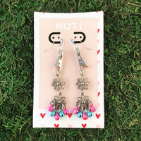 HOTI Hemp Handmade Floral Bells of Joy Antique Silver Pink Pale Light Blue Metallic Women's Ladies Woman Her Flower Power Roach Clip Earrings Dangling Metal Hollow Petal Charm Handcrafted Made in Toronto Made in Ontario Made in Canada Flowers Mini Steel Bell Signature Sterling Silver Ear Wires Paper Earring Card 420 Alligator Clips Marijuana Mary Jane Cannabis Clip It Roach Clips Dope Stoner Gift Toronto Ontario Canada Canadian Valentine's Day