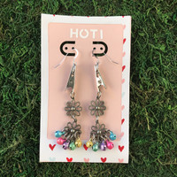 HOTI Hemp Handmade Floral Bells of Joy Antique Silver Pink Pale Light Blue Green Purple Yellow Metallic Women's Ladies Woman Her Flower Power Roach Clip Earrings Dangling Metal Hollow Petal Charm Hand Crafted Made in Toronto Made in Ontario Made in Canada Flowers Mini Steel Bell Signature Sterling Silver Ear Wires Paper Earring Card 420 Alligator Clips Marijuana Mary Jane Cannabis Clip It Roach Clips Dope Stoner Gift Toronto Ontario Canada Canadian Valentine's Day