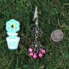 HOTI Hemp Handmade Floral Bells of Joy Antique Silver Purple Pink Metallic Women's Ladies Woman Her Flower Power Roach Clip Dangling Metal Hollow Petal Charm Hand Crafted Made in Toronto Made in Ontario Made in Canada Flowers Mini Steel Bell Signature 420 Alligator Clips Marijuana Mary Jane Cannabis Clip It Roach Clips Dope Stoner Gift Toronto Ontario Canada Canadian
