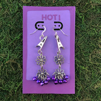 HOTI Hemp Handmade Floral Bells of Joy Antique Silver Purple Metallic Women's Ladies Woman Her Flower Power Roach Clip Earrings Dangling Metal Hollow Petal Charm Hand Crafted Made in Toronto Made in Ontario Made in Canada Flowers Mini Steel Bell Signature Sterling Silver Ear Wires Paper Earring Card 420 Alligator Clips Marijuana Mary Jane Cannabis Clip It Roach Clips Dope Stoner Gift Toronto Ontario Canada Canadian