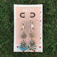 HOTI Hemp Handmade Floral Bells of Joy Antique Silver Pale Light Blue Silver Metallic Women's Ladies Woman Her Flower Power Roach Clip Earrings Dangling Metal Hollow Petal Charm Hand Crafted Made in Toronto Made in Ontario Made in Canada Flowers Mini Steel Bell Signature Sterling Silver Ear Wires Paper Earring Card 420 Alligator Clips Marijuana Mary Jane Cannabis Clip It Roach Clips Dope Stoner Gift Toronto Ontario Canada Canadian Valentine's Day