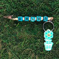 HOTI Hemp Handmade Grass Beige Natural Hemp Keychain Roach Clip Key Chain Turquoise Blue Wood Cube Square Alphabet Beads Word Up Made in Canada Hand Crafted Made in Toronto Made in Ontario Beaded Weed Pot Accessories Cannabis Marijuana Mary Jane Accessory Dope Stoner Gift 420 Clip-It Alligator Clip Canadian Toronto Ontario Canada Handcrafted