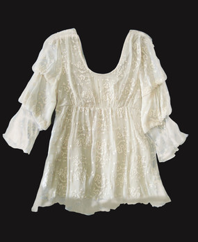 "Sagrada - Romantic blouse with 3 tiered puff sheer sleeves and empire line bodice, featuring scoop front neckline and truncated ""V"" back neckline and a lined bodice.  made of 100% silk textured georgette delicately embroidered with cotton thread in ""droplet"" pattern."