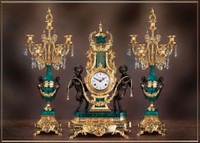 A Crystal and Green Malachite Garniture, Brass Ormolu Guirlande de Butin Clock, 26.37 Inch, Seven Branch Candelabra Set, Imperial Handmade Italian Reproduction in 24 Karat Gilt Patina