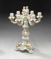 A Meissen Style Tabletop, 21.5t X 16.5w X 16.5d Porcelain Candelabrum, Cherub Motif