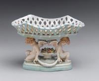 A Meissen Style Tabletop, 10L X 7t X 6d Porcelain Basket Compotier | Bowl, Cherub Motif