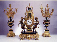 An Imperial Handmade Reproduction Garniture, Gilt Brass Ormolu Nero Marquinia Italian Marble Clock & 7 Branch Candelabra Pair, French Gold Finish