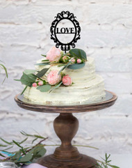 "LOVE framed acrylic cake topper - the word ""Love"" laser cut in a frame"