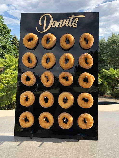 Black acrylic donut stand with gold mirror made in Melbourne Australia