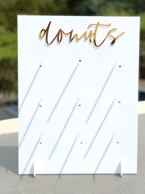 Gold mirror on white acrylic donut stand