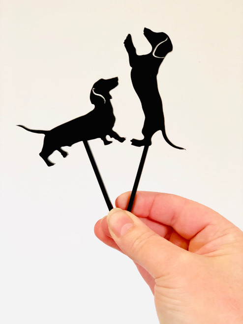 Two little Daschund dog cake toppers