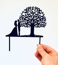 Couple with Tree of Life wedding cake topper made in Australia